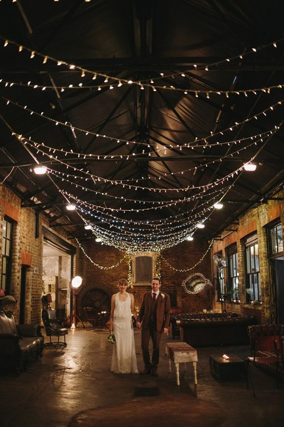 Go full Gatsby on a barn-like structure like this atmospheric urban East London wedding. Loving the Chesterfields. Photography by Emilie White.