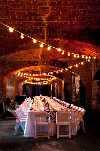 Industrial weddings highlight the simplicity of decor. Check out this Key West wedding at Fort Zachary Taylor. Photo: JHunter Photography.