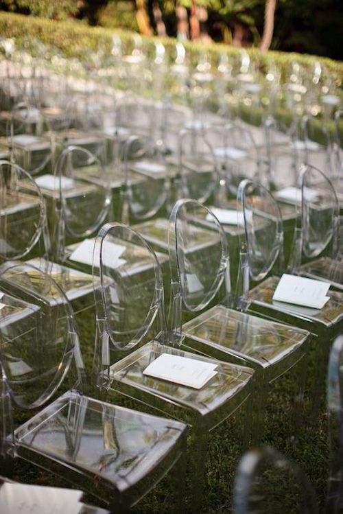 Add a contemporary twist to your wedding seating with lucite chairs. One of this season's hottest wedding trends.