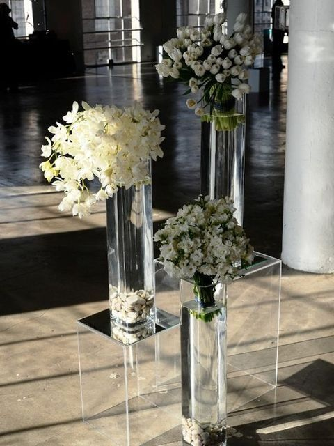 Head over heels with these lucite wedding decor ideas. It seems as if the don't take up any space at all!