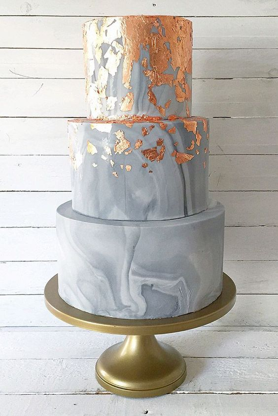 Elegant three-tiered gray marble and metallic wedding cake.