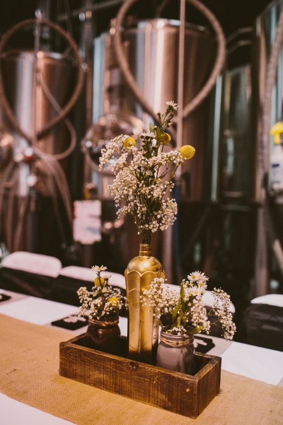 If you've been on the hunt for fresh and modern wedding ideas, the centerpieces of this industrial wedding at a California brewery are fire.