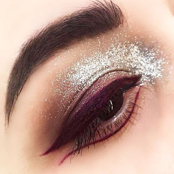 Purple eyeshadow and liner, bold mascara and silver glitter by @eleonoragobbo via MAC cosmetics.