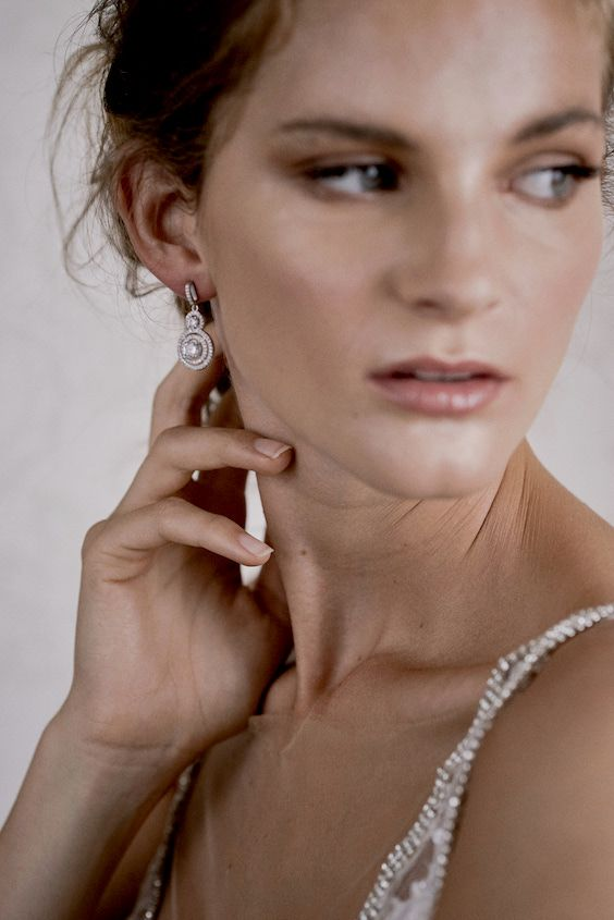 This delicate round pearl earring is the perfect accessory for her wedding dress. Sephory Photography.