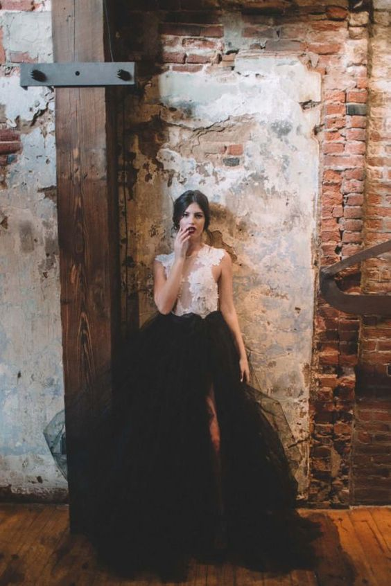 A white lace bodice with a black tulle skirt? This urban glam bride absolutely wins this year's bridal fashion. Wedding Separates Gwendolyn Bodysuit.