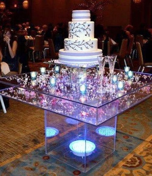 Showcase your wedding cake on top of this amazing acrylic table.