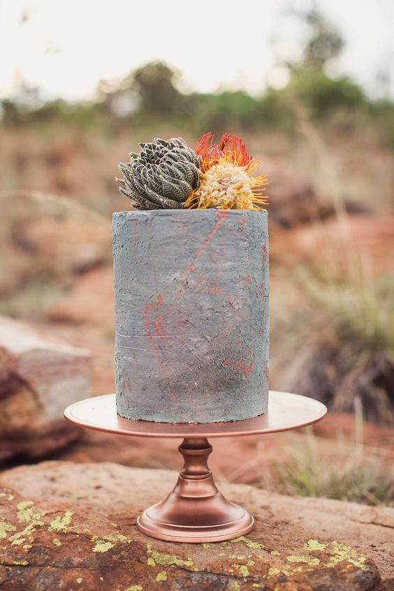 If you are anything like us, this tall one tier concrete cake will steal your heart. It boasts an industrial vibe merged with bohemian rusticity. Photo: Because Life Photography.