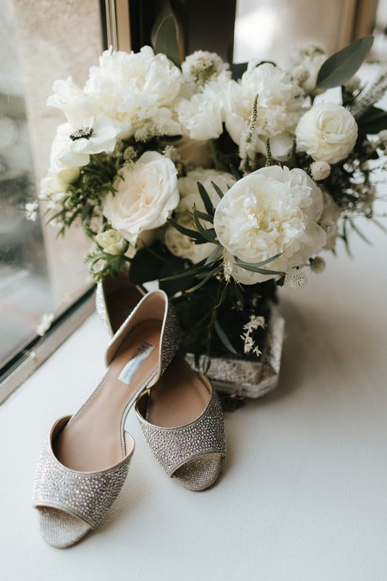 White ranunculus on your bridal bouquet and sparkly silver shoes for your big day. Wedding Photography: Gallivan Photo.