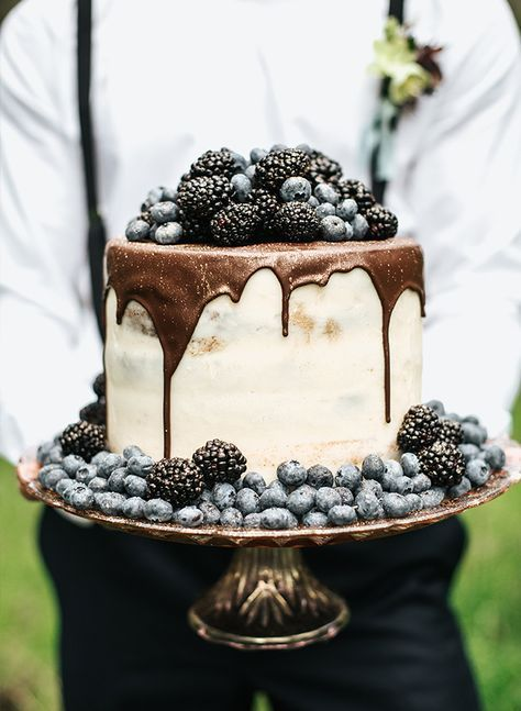 Very berry chocolate drip cake delight for an intimate garden wedding.