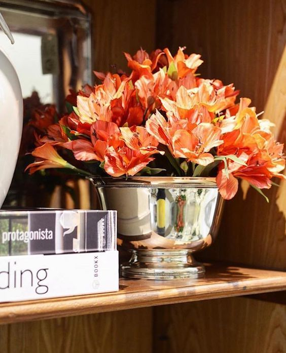 Head-turning coral amaryllis centerpiece, a focal point of your reception table decor.