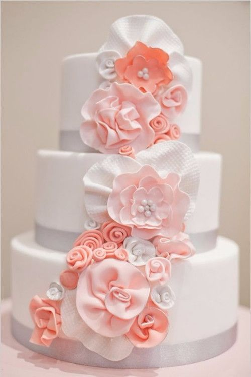 Romantic and lively coral and white wedding cake.