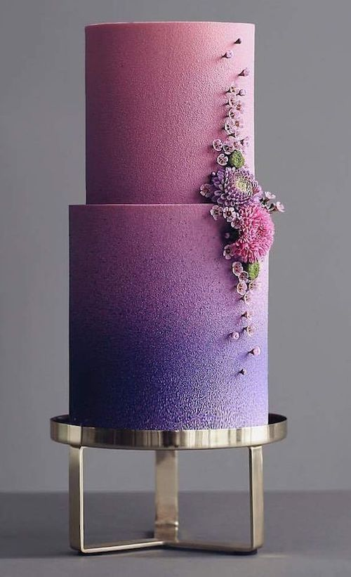 Design perfection on a cake that goes from purple to pink with the most delicate floral design by cakecoachonline.
