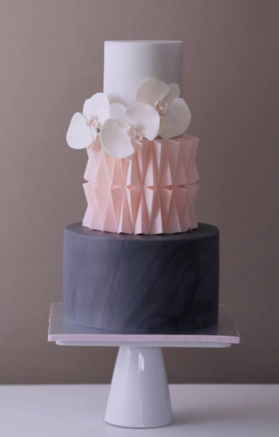 A design masterpiece by Crummb cakes in white, pink and blue with edible flowers.