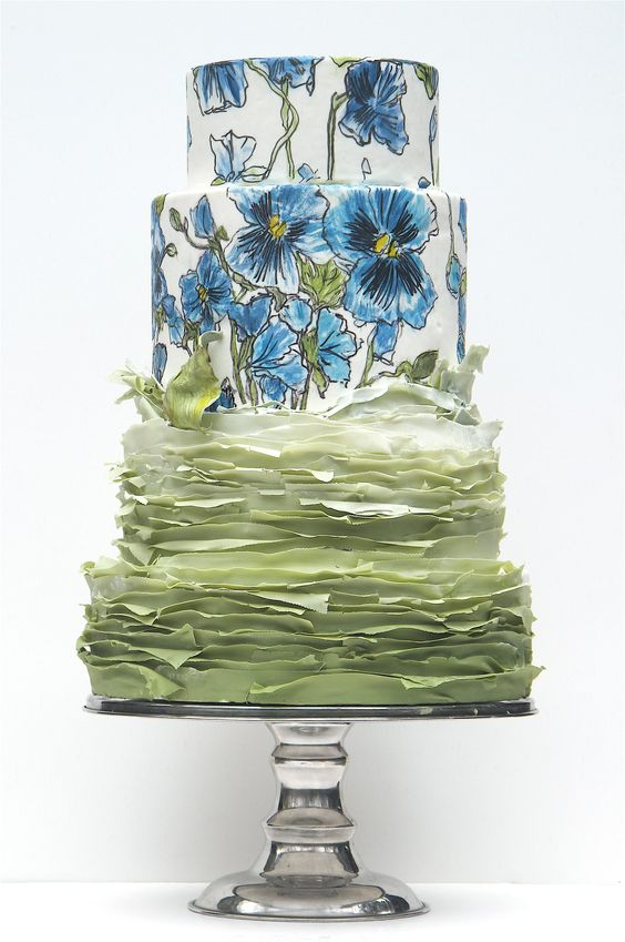 Fab hand painted wedding cake tiers over multitiered green Sfogliatella or Mille Feuilles. One of the latest additions to the world of wedding cakes.