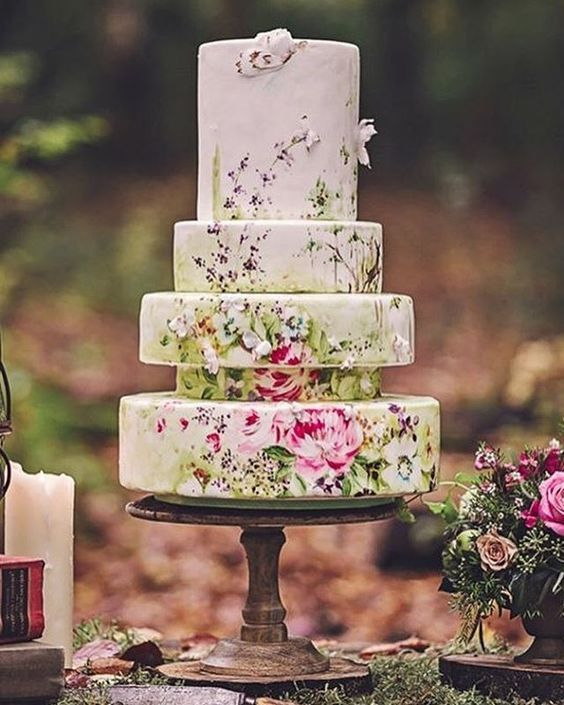 Hand painted cake art over a unique five-tiered wedding cake.