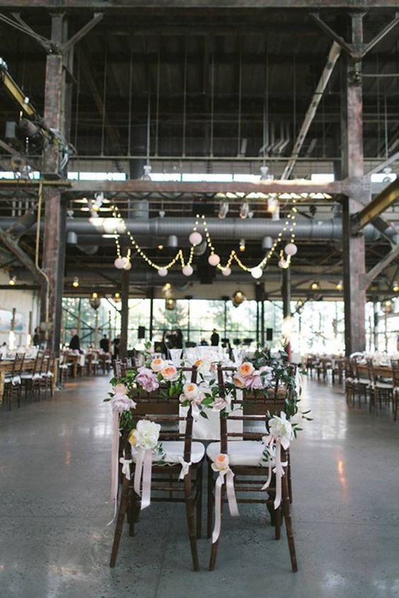 Elegant industrial loft winter wedding ideas. Simplicity in reception decor. Photo: Love Me Do Photography.