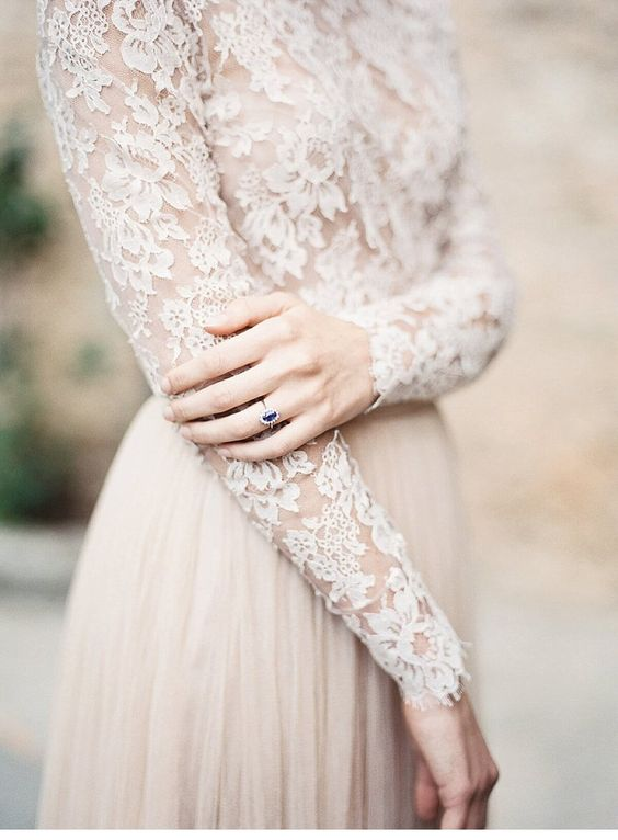 Long sleeve wedding gown. Tuscany elopement by Lara Lam Photography.