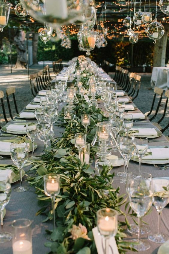 Candles, hanging glass baubles and greenery runners create a gorgeous wintry atmosphere at this outdoor Napa wedding at Beaulieu Gardens. Photos by The Edges Wedding Photography.