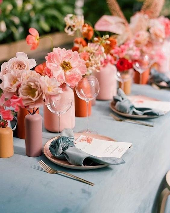 Tablescape for a romantic and joyful outdoor wedding in coral, pink and grey. Living coral wedding decor ideas.