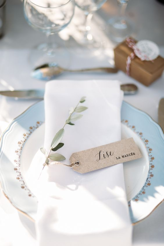 Simple place card tags, delicate white and blue china. French vintage winter wedding ideas.