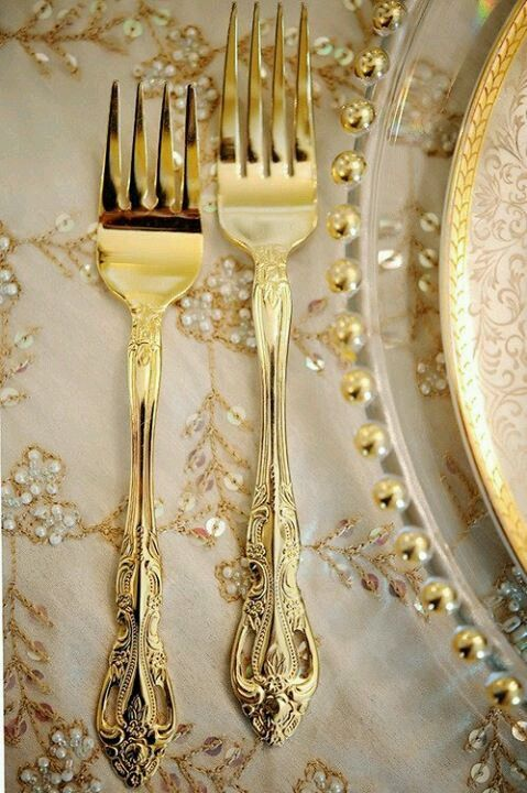 So wintery looking and so glam, silverware in gold with encrusted pearls.