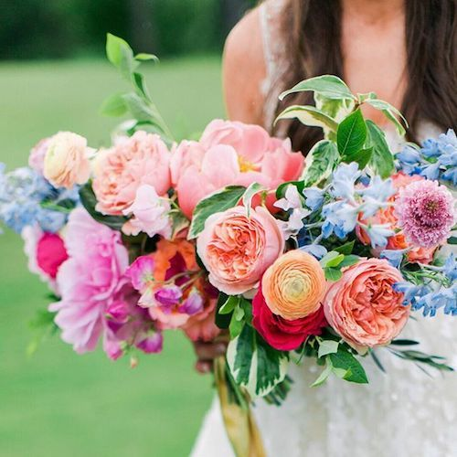 Fuchsia, peach, orange, blue and red blooms is the perfect color explosion for a summer wedding bridal bouquet.