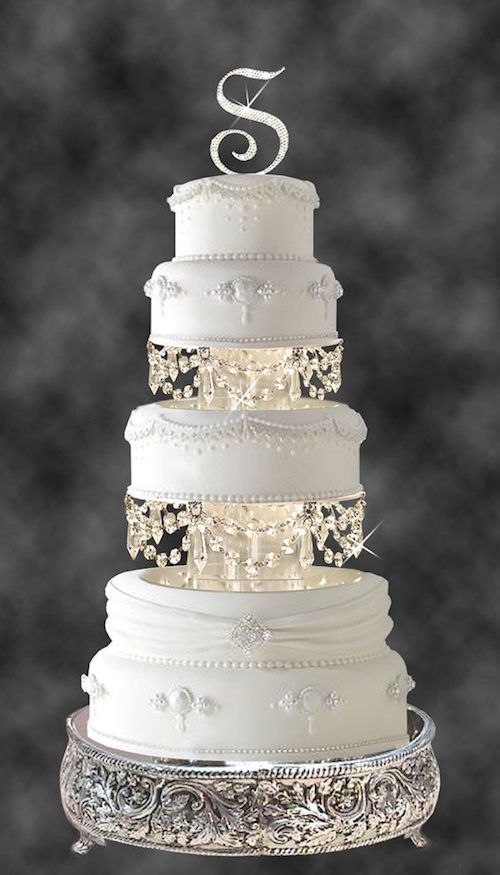 Not everything is modern lines on unique wedding cake designs. Check out this superb Swarovski crystal and rhinestone chandelier tiered set!