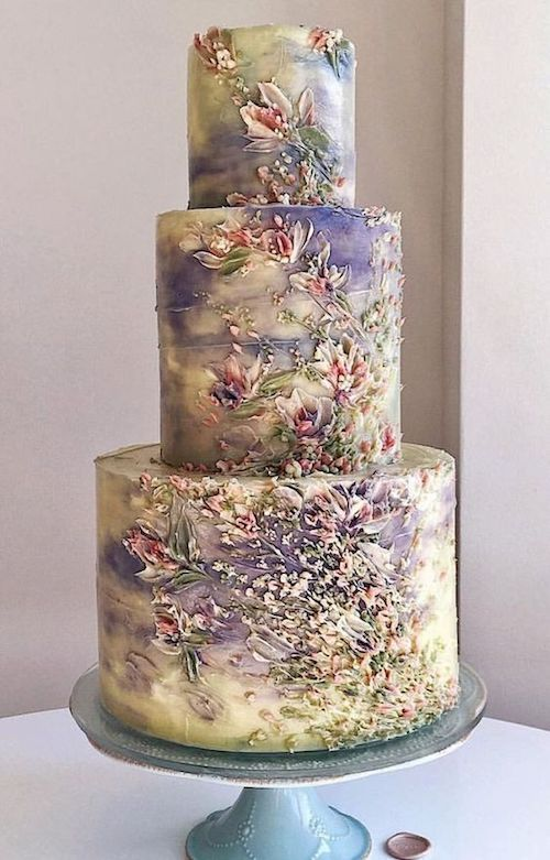 We are swept away with these unique wedding cake designs. Especially the details on this cake.