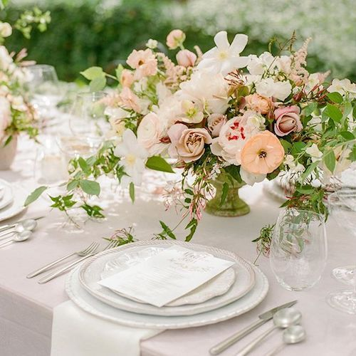 Vintage garden table setting with an elegant and romantic vibe.