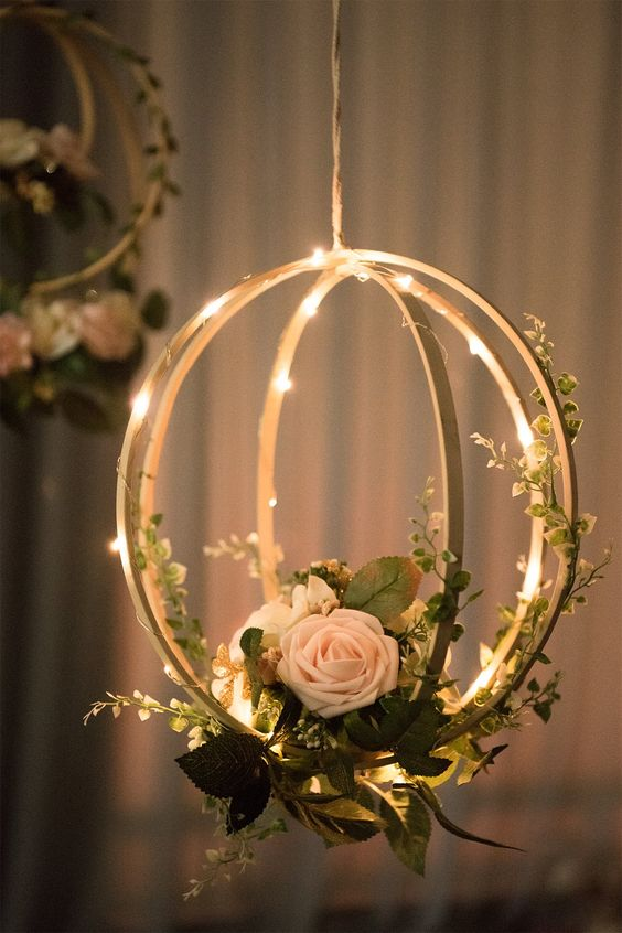 Hanging florals and LED lights can be made out of wooden hoops to add more magic to your wedding ceremony.