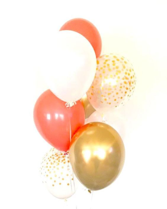 Balloons are an affordable and fun element in wedding decor. Why not add some coral to the mix?