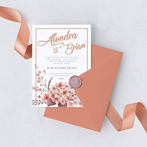 Loving the living coral and mauve combo on these wedding invitations.