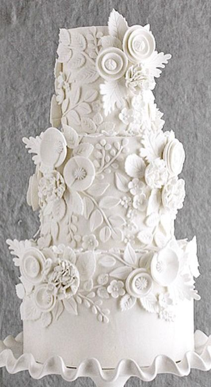 Stunning white wedding cake that will impress your guests like none other.