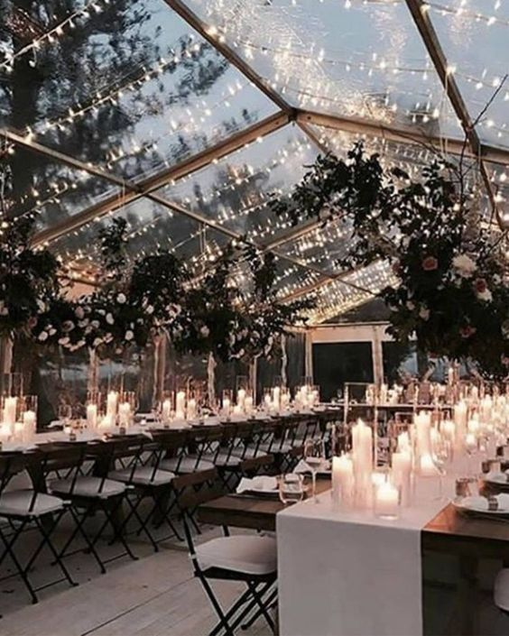 Enjoy the winter night sky under a swoon-worthy clear tented wedding reception.