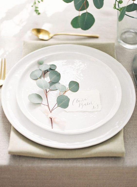 Silver dollar eucalyptus to make your place cards more impressive.