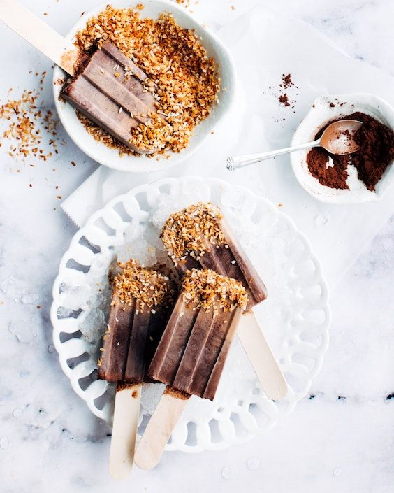 Homemade chocolate fudgsicles dipped in cereal. Food Photographer: Jennifer Pallian.