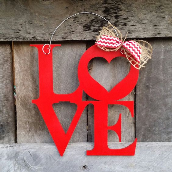 Surprise him when he knocks at the door with a loving red sign.