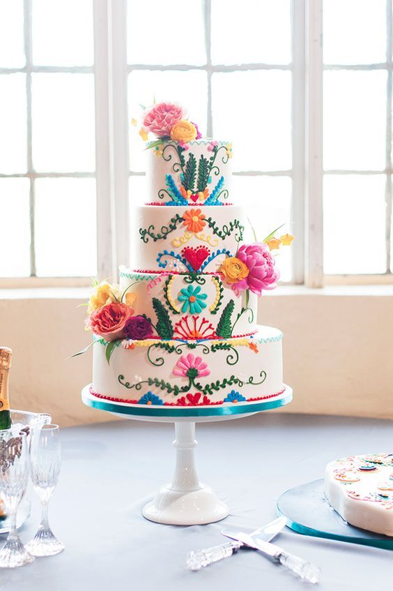 Personalized and hand painted, colorful, festive Mexican-inspired wedding cake. Photo: Ely Fair Photography.