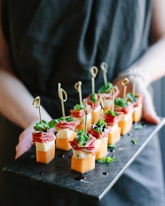 Add some appetizers to pass around while your guests are in line waiting to get to the charcuterie platters.