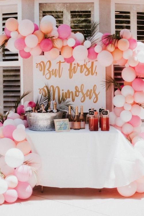 Throw the best bridal shower ever! Decorate the mimosa bar with pink balloons and a calligraphy sign (from In Jessiland)