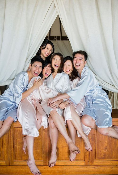 Let the fun times begin! Planning is almost over so, enjoy the company of your bridesmaids and bridesmen in beautiful pink and blue silk dressing robes! Photo: theweddingscoop.