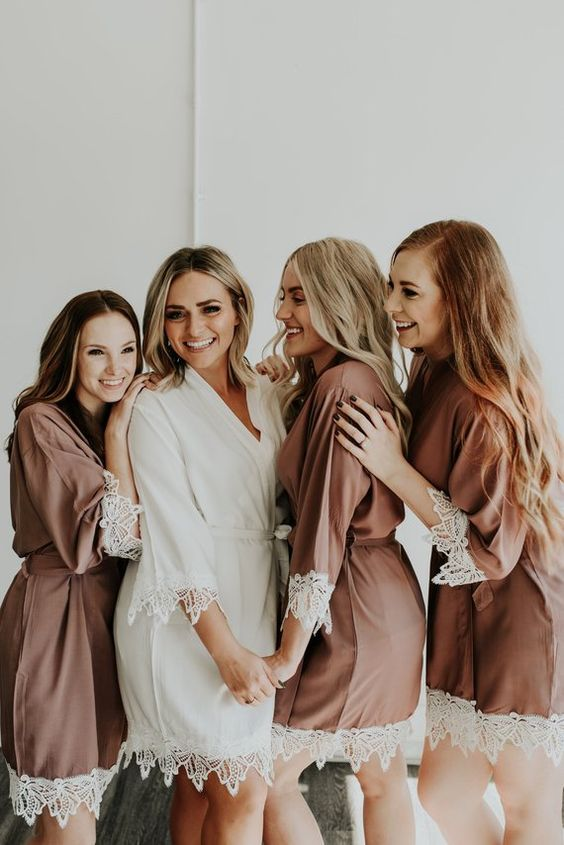 A robe always comes in handy when you and your bridesmaids are getting ready and they can always treasure it as a keepsake after the big event.