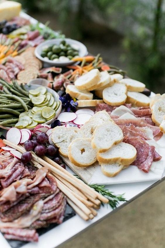 Charcuterie boards include meats served with cheeses, sweets, breads and tangy-pickles in bite-sized portions.