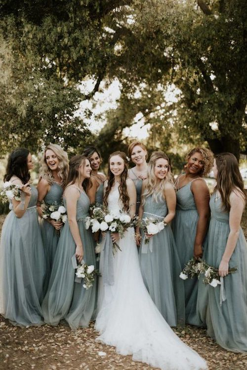 Dusty blue is such a becoming color - your bridesmaids will love it - and perfect for this farm wedding.