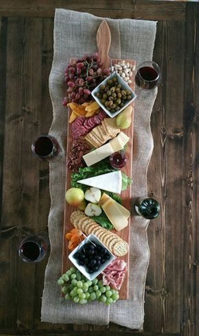 "Go for a gorgeous charcuterie board or table to impress your guests and let them feel cozy. A charcuterie board with lots of salami and sausages, cheese over a 42"" extra large serving platter made in Homerville, Ohio."