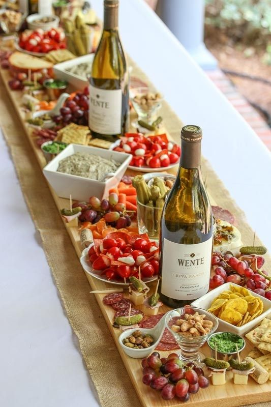 Complete guide for how to setup a charcuterie board for wedding receptions. Here as a table runner by a forks tale.