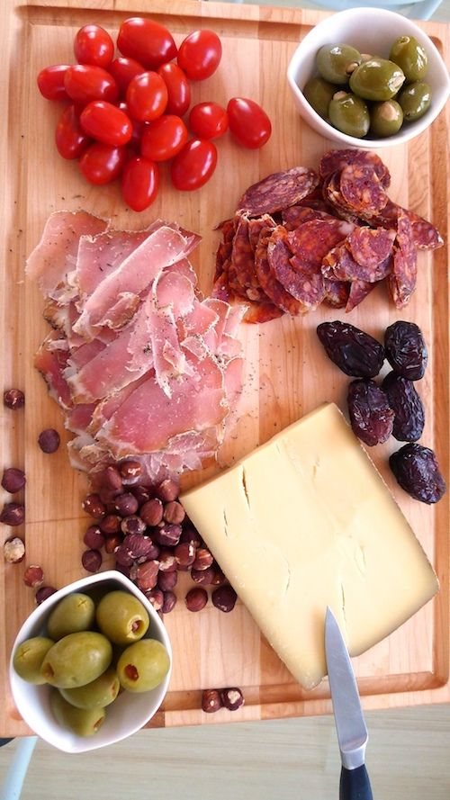 How to setup a charcuterie table for your wedding, step by step.