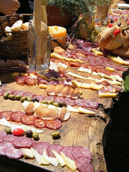 Italian themed charcuterie board. Discover how to make a charcuterie board that is fire.