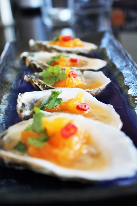 Oysters with citrus vodka for an epicurean grazing table.
