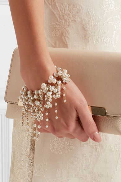 Don't forget to accessorize in style. Italian lobster clasp fastening pouch with freshwater pearls.